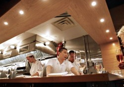 Peter Serpico, a chef-partner at Momofuku Ko, speaks to patr