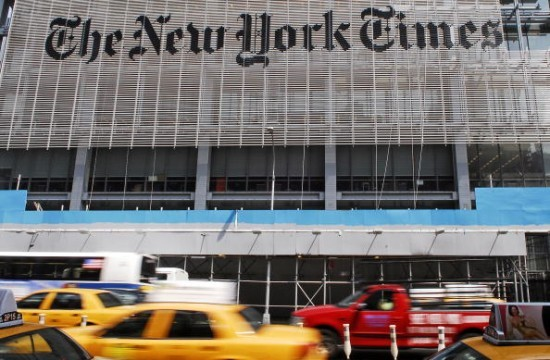 Traffic drives past The New York Times Building in New York,