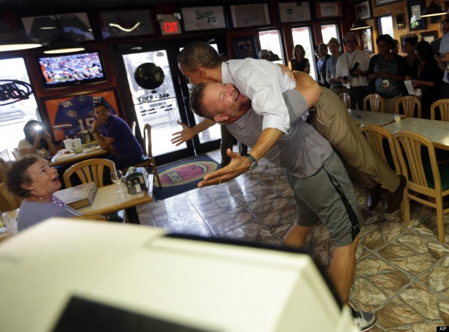 man picks up Obama