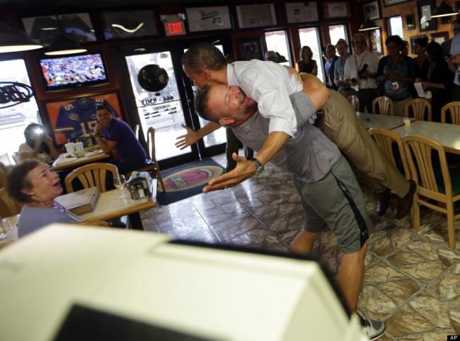 man picks up Obama