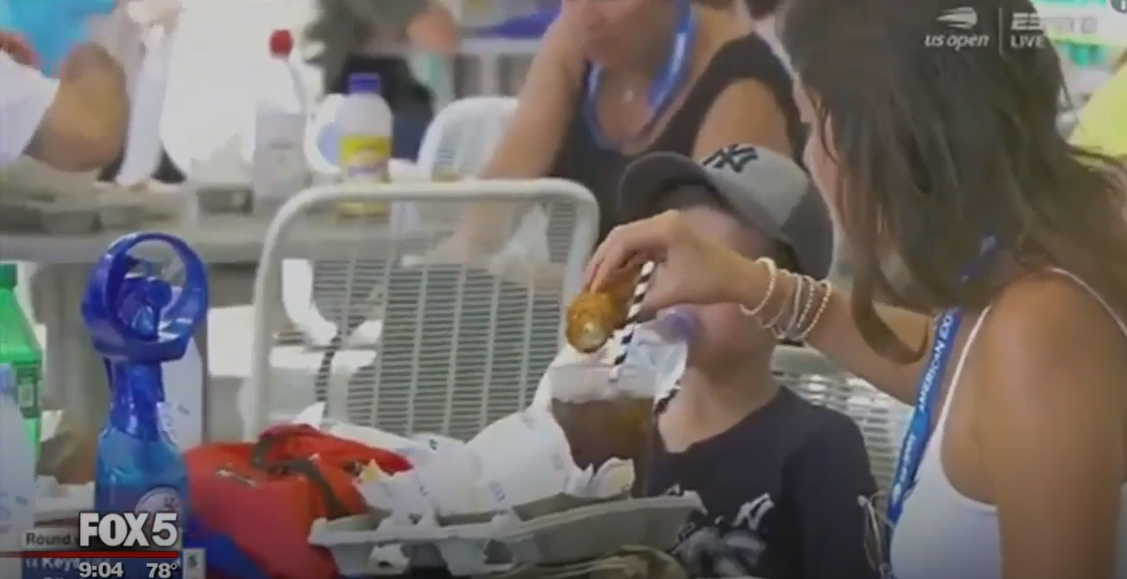 What on Earth is This Tennis Fan Doing Dunking a Chicken Finger Into Her Soda?