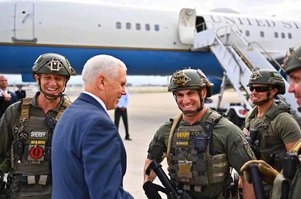SWAT Officer Demoted For Wearing QAnon Patch With Mike Pence
