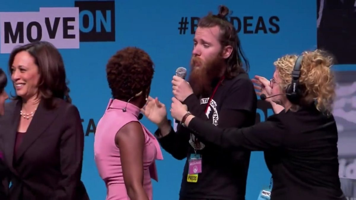 WATCH: Sentient Man-Bun Rushes Kamala Harris Onstage, Gets DRAGGED Off After Stealing Mic