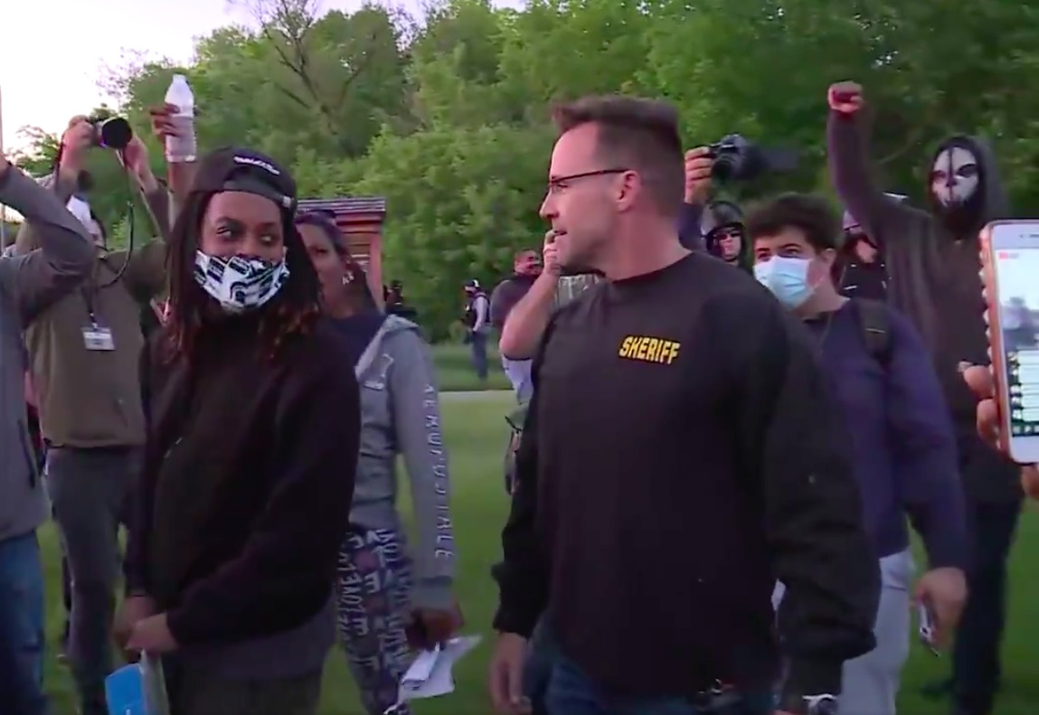 Sheriff and Officers Join Protesters in Flint, Michigan