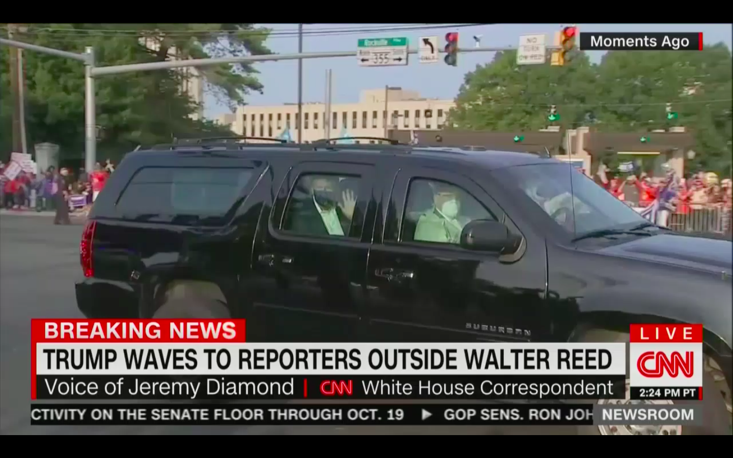 BREAKING: Trump Spotted in SUV Waving to Supporters Driving Around Walter Reed